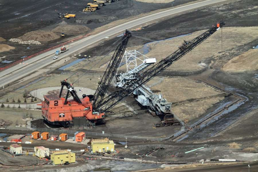 Robert Johnson — Business Insider. A dragline crane on the left, and a gray bucketwheel to the right.