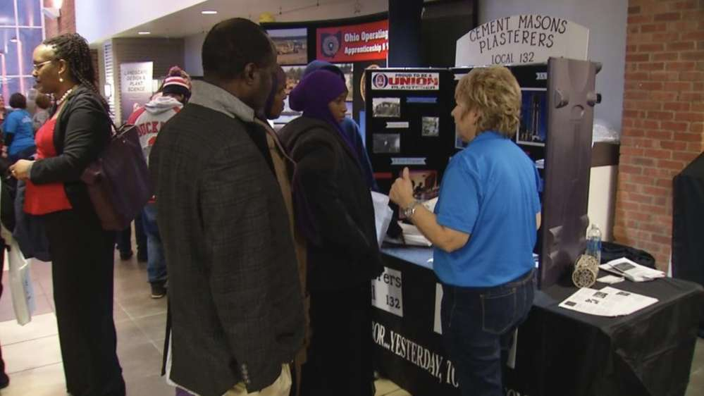 Visitors to the job fair discuss taking on a trade skill with a booth representative. (WSYX/WTTE)