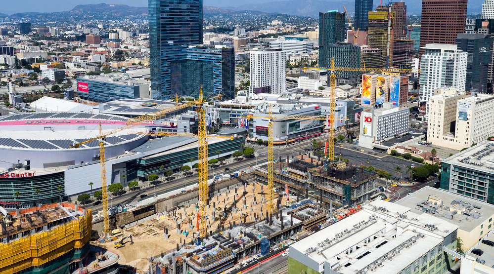 Giant cranes dominate the forefront of this aerial view of the city. (Hunter Kerhart)