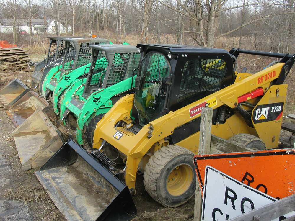Equipment up for bid included this lineup of skid steers.