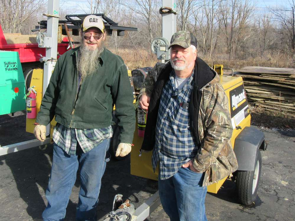 Ted Lutton (L) of Big Bear Deer Farms joins Mike Petronio of M&C Construction to look for bargains.