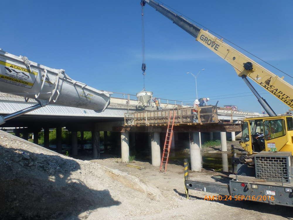 Capital Excavation is placing a concrete cap for the I-35 bridge expansion over Lake Creek.