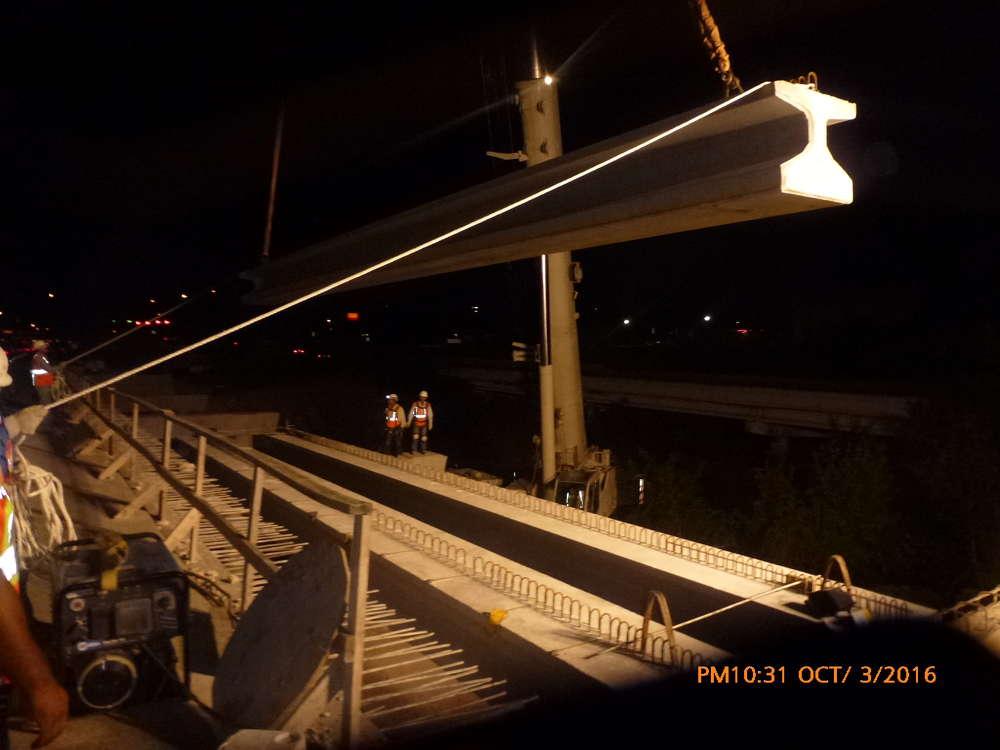 Crews set TX28 concrete girders at Lake Creek.