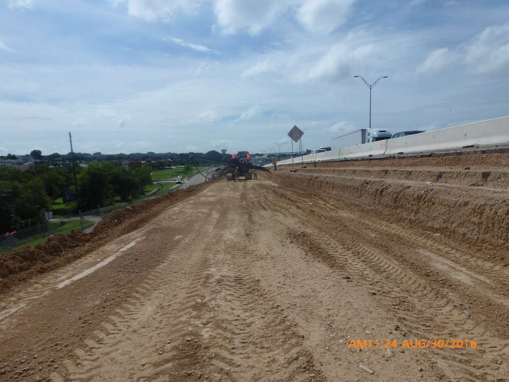 The beginning of excavation and soil nail placement along the northbound frontage road to I-35.