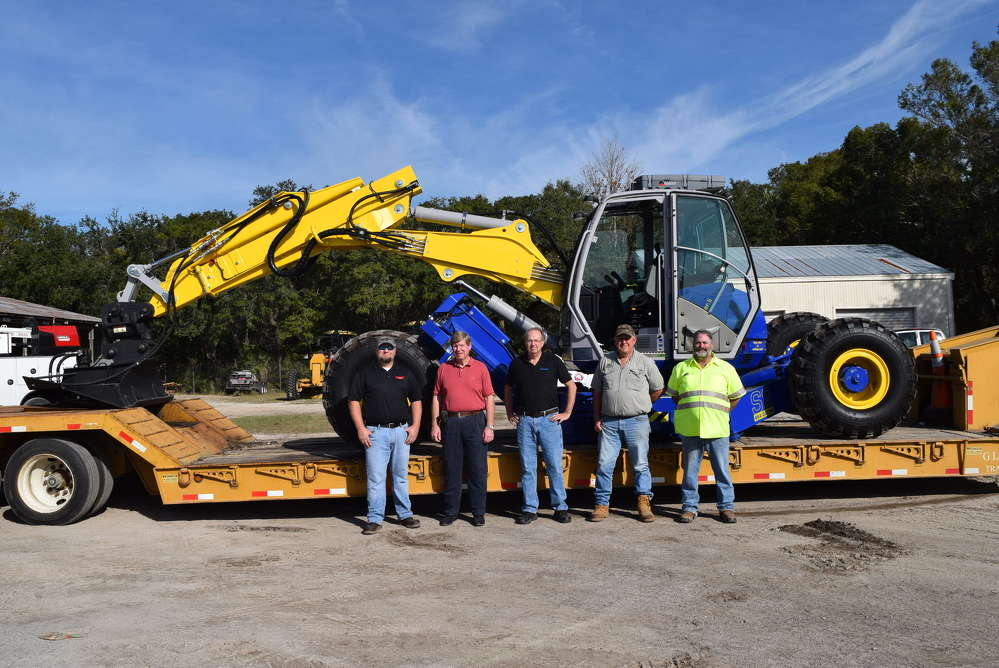 """(L-R) are Mike Knowles, sales representative of GS Equipment; H.P. """"Press"""" Tompkins, public works director of Putnam County; Lanny Hollifield, vice president of Kaiser sales and service of GS Equipment; Roger Cobb, operator trainer of GS Equipment; and Matthew Thompson, operator of Putnam County."""