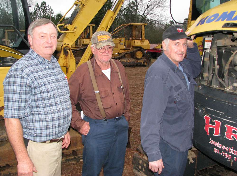 (L-R): Ricky Dukes, Williams Truck & Equipment, Tampa, Fla.; Leonard Hairel, contractor based in Fort Payne, Ala.; and Danny Wagner, Wagner Excavation, Fort Payne, Ala., look over some of the mini-excavators at the auction.