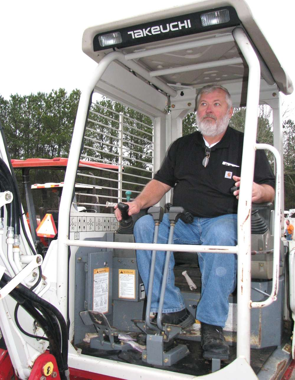 David Davis, Davis Sales, Anniston, Ala., tests this Takeuchi TB-138FR.