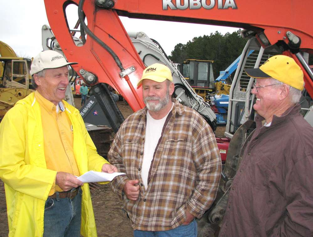 (L-R): Danny Gibbs, Bowden, Ga.; Charles Turner, Heflin, Ala.; and Terry Shealy, Tallapoosa, Ga., share a laugh before the auction