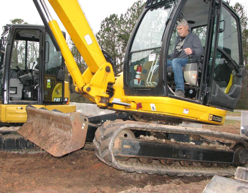 Gaston Pace, Pace Truck & Equipment, Perkinston, Miss., tests the hydraulics of this JCB 8080zts mini-excavator.