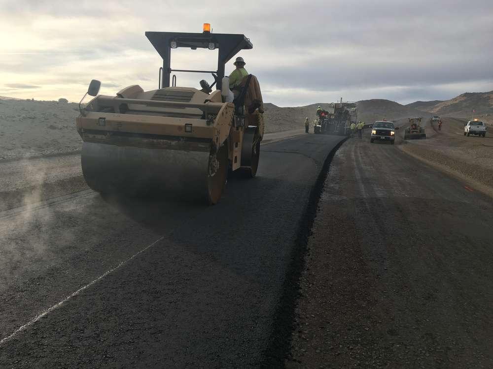Granite crews placing asphalt pavement on USA Parkway.