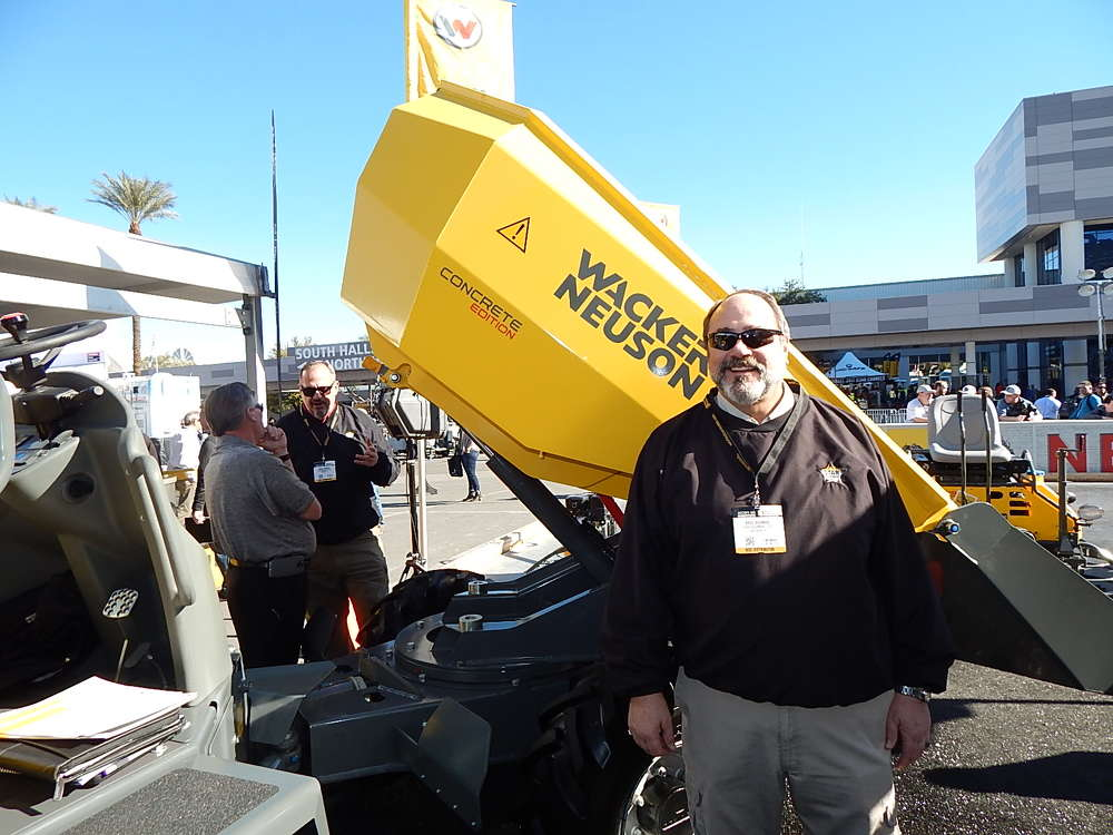 Brad Bowman, owner of Star Equipment, with four locations in Iowa and a Wacker Neuson dealer, stands next to the new Wacker Neuson 3001 concrete dumper, a 3-ton dumper outfitted with a specially designed concrete chute that allows precise placement of product.