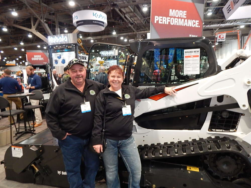 "Rick and Robin Nation from Springfield, Ore., Nation's Mini-Mix, a small yardage concrete specialist, are checking out the new Bobcat T595 track loader. ""This is a great show for concrete people like us,"" said Rick. ""Great equipment and lots to see."""