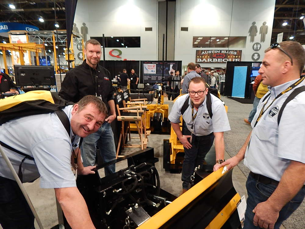 (L-R): The GPlant crew out of Midlands, England, came all the way across the pond to take a look at all the new equipment and services for the concrete industry at WOC 2017. (L-R): Owner Gary Plant with HitchDoc Vice President Chad Mohns; GPlant operators Trevor Bell and Tom Burrows look over this HitchDoc innovative 6 way 96-in. skid steer blade. HitchDoc of Jackson Minn., debuted new innovative attachments at WOC 2017.