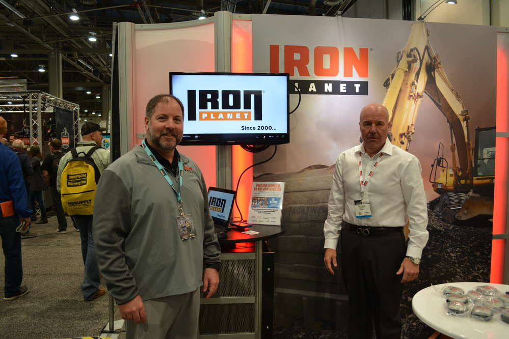 Jeff Fisher (L), major accounts manager, and Scott Walter, vice president of major accounts, represented IronPlanet at World of Concrete.