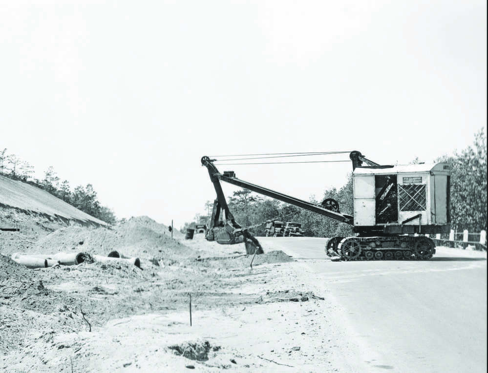 National Archive photo - All Depression Era W.P.A. work was designed to employ as many workers as possible and Arute's job was no exception. The photo taken June 3, 1935 depicts workmen hand raking dense graded stone base on the roadway.