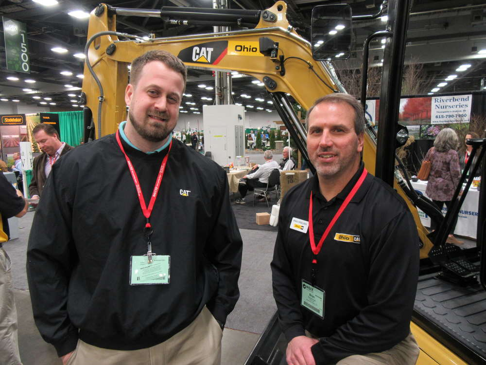 Tom Miller (L), Caterpillar, joins Brian Speelman, Ohio CAT, to welcome attendees to the Ohio CAT booth.
