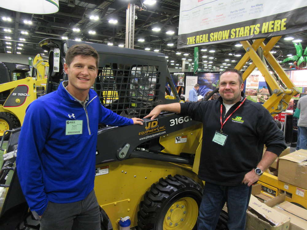 Taylor Dunifon (L) and Jason Snyder, both of JD Equipment, discuss landscape and nursery equipment-based solutions.