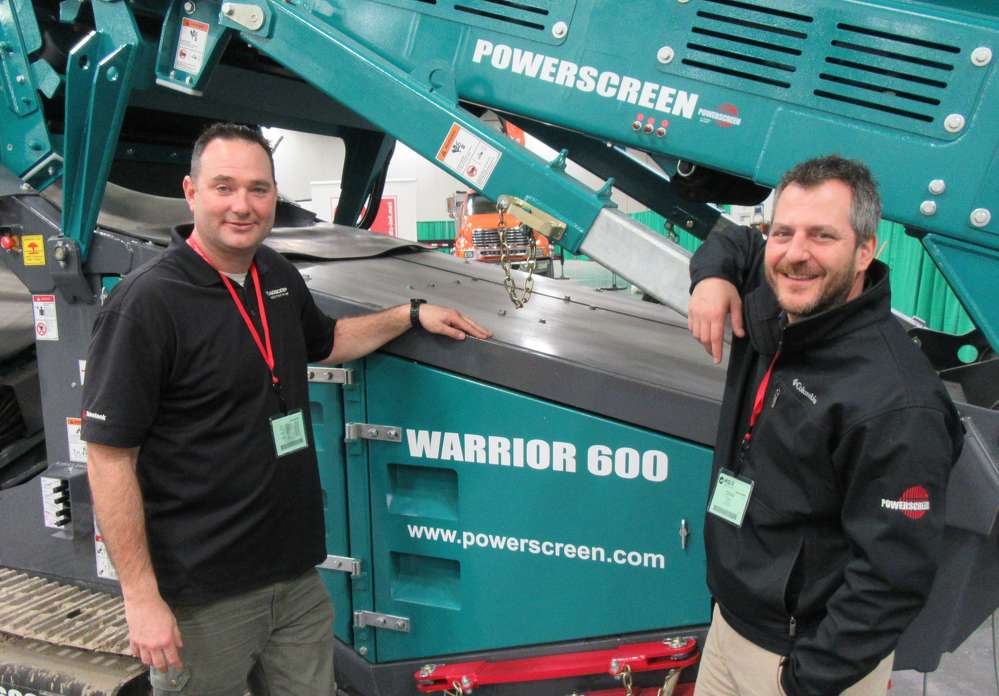 Roberto Armbruster (L) and Chris Toigo, both of Aggcorp, introduced Powerscreen's new Warrior 600 compact scalping screen, capable of processing up to 300 tons (272 t) per hour, at the show.