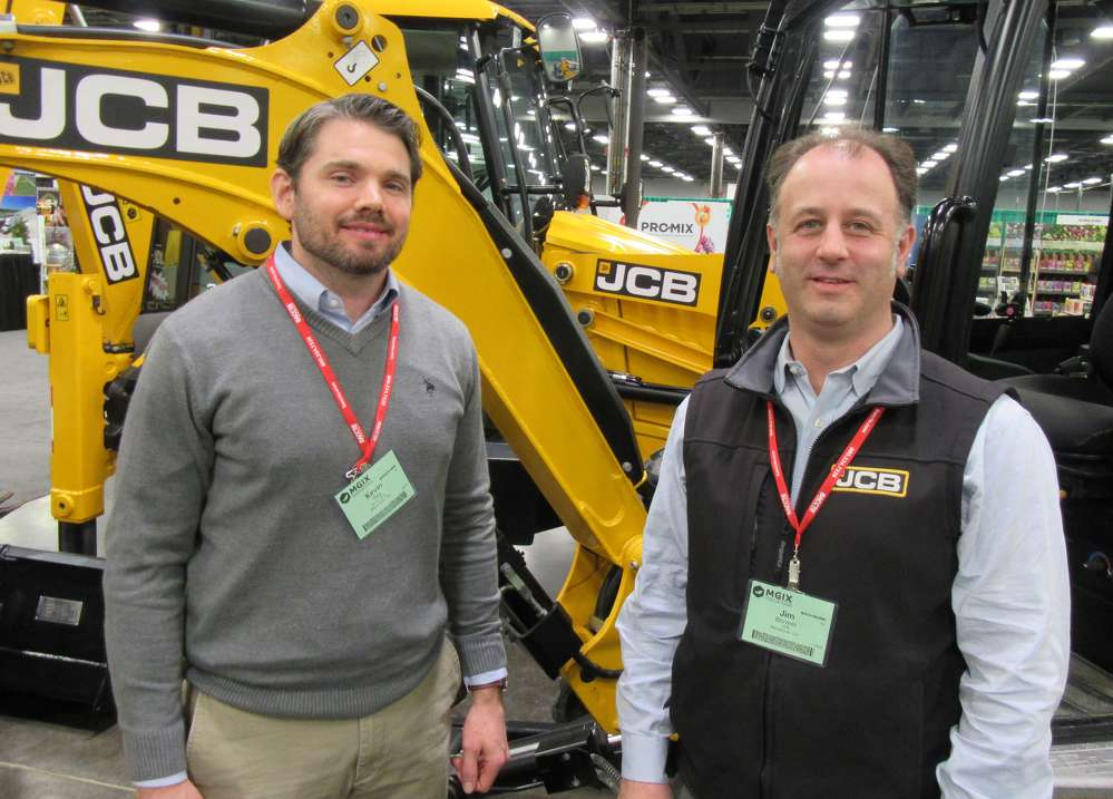 Kevin Ray (L) of Burns JCB and Jim Blower, regional business manager, JCB North America , attend the show.