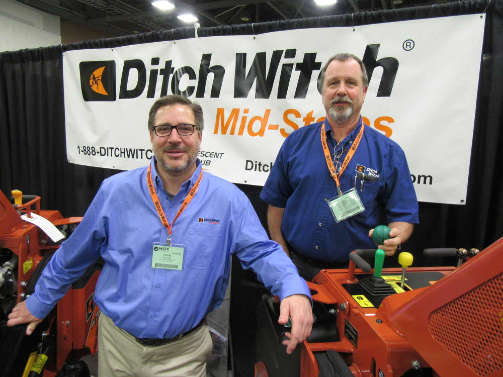 Chris Petrolio (L) and Jim Pape, both of Ditch Witch Mid-States, welcome attendees to the company's equipment display at the show.