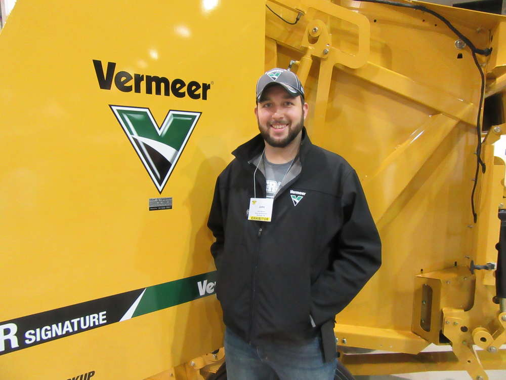 Josh Busby of Shaw Ag Equipment displays Vermeer machines at the show.