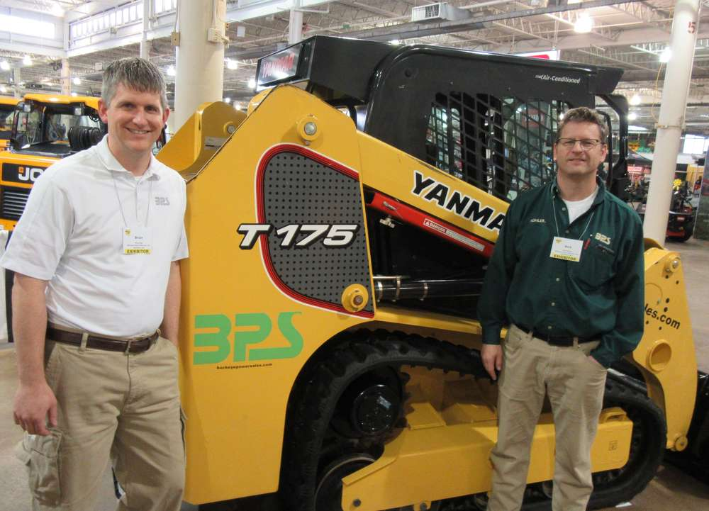 Brian Will (L) and Rick Pileski, Buckeye Power Systems, talk about the company's lineup of Yanmar equipment at the show.