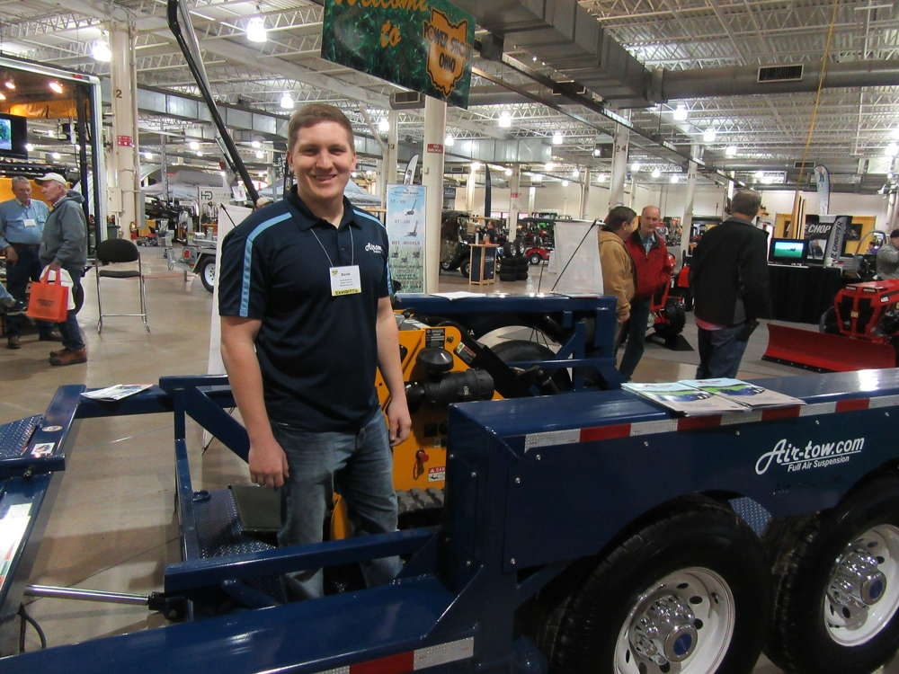 David Gerstner of Air-Tow Trailers demonstrates the trailer's ground level loading feature.