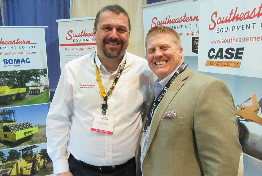 Mike Zalewski (L) of Southeastern Equipment Company shares a laugh with Steve Gorman of IronPlanet at the event.