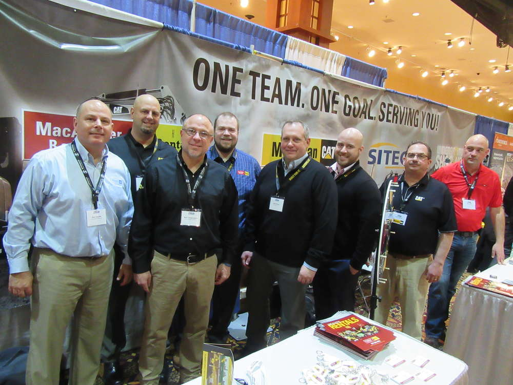 (L-R):?Bob Daudlin, Chad House, Nick Langenderfer and Shawn Miller, all of MacAllister Rentals, join Brian Schulz, Dan Muncie, John Miriani and Brian Erler, all of Michigan CAT, to answer questions about the lineup of Caterpillar equipment.