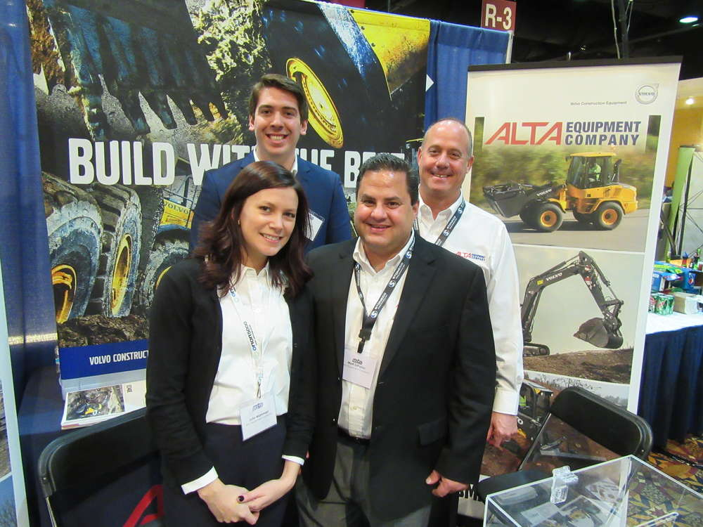(L-R):  Julie Marsman, Austin Bayley, Matt DiPonio, and Gary Mercer, all of Alta Equipment Company, talk with attendees about the dealership's lineup of Volvo, Gehl, Takeuchi and Link-Belt Crane equipment.