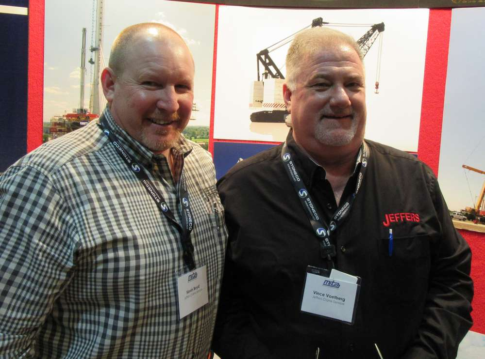 Kevin Boyd (L) and Vince Voetberg, Jeffers Crane Service, discuss the company's full range of crane equipment.