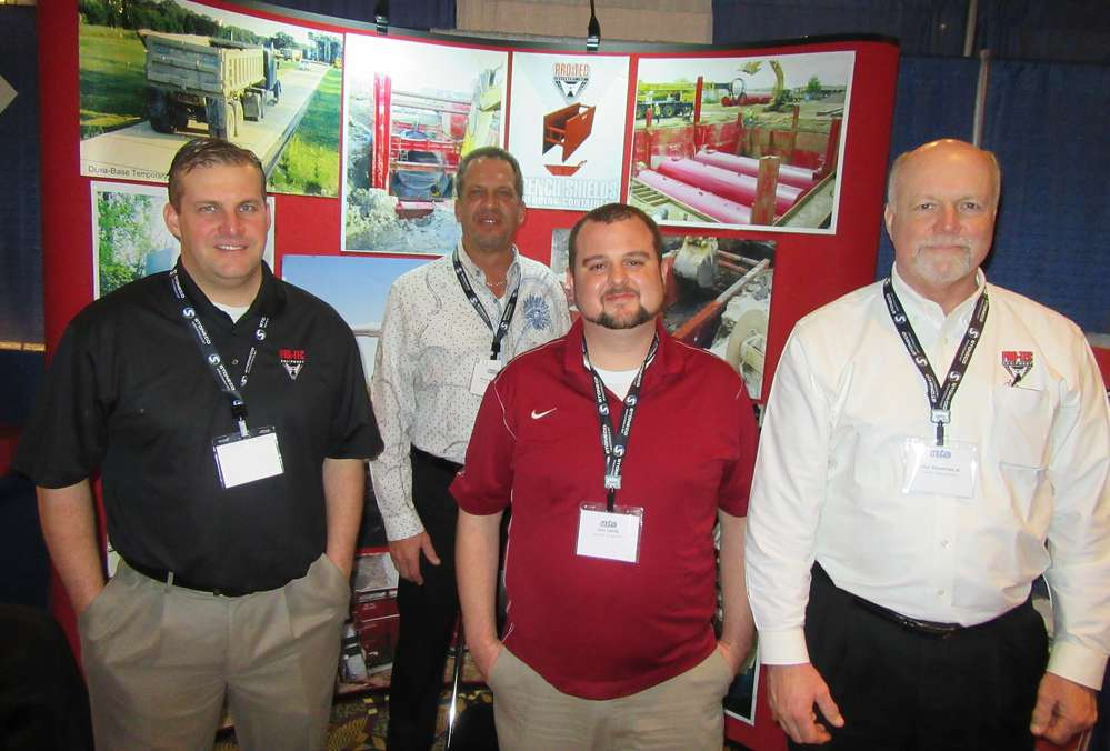 Joe Cook, Dave Miedema, Jon Lentz and Paul Rosemeck, all of Pro-Tec Equipment, man the  company's booth and talk about trench safety.