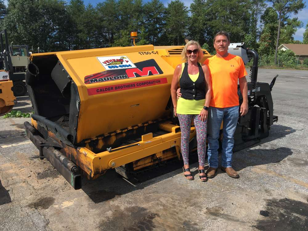 Lynne and Gary Venesky stand in front of their new Mauldin 1750C paver.