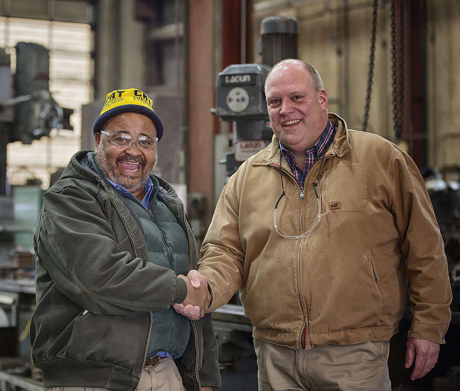 Jimmie Thompson (L), Thompson service operations supervisor and Tim Anderson, Thompson used equipment sales manager.