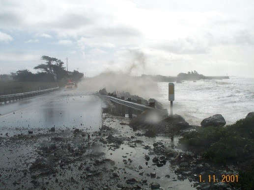 Waves cover Highway 1 at Piedras Blancas.