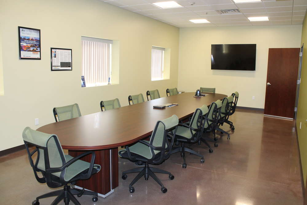 The new conference room has radiant floor heating, and bright welcoming color and décor to feel comfortable and work more effectively.