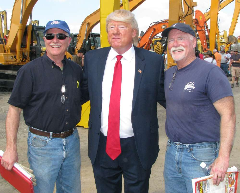 Bill Carroll (L) of Carroll Equipment, Weedsport, N.Y., and Dave Carroll (R) of CNY Rack & Surplus, Syracuse, N.Y., take a moment to get their photo taken with Jack's special guest.