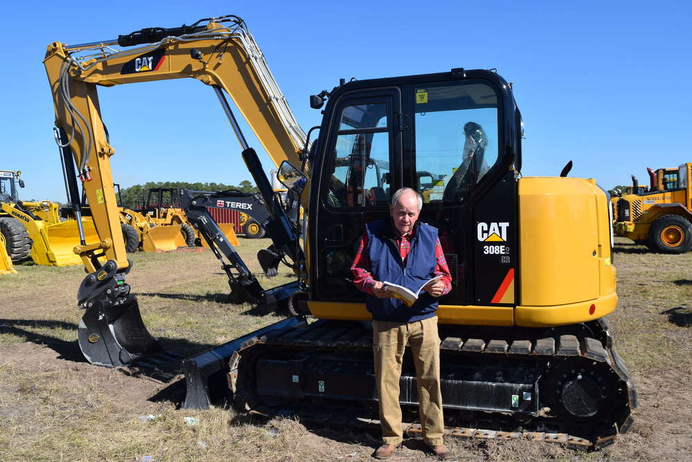 From Fairhope, Ala., Terry Barksdale of Alex Lyon & Son ensures this Caterpillar 308E excavator was listed correctly in the program and ready to sell.