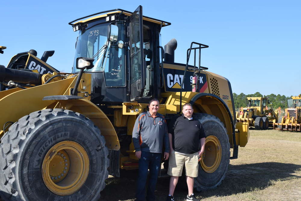 Sam Duncan (L) and Mike Phillips of Nationwide Transport Services were roaming the Alex Lyon & Son sale and stopped to look at this Caterpillar 966K wheel loader