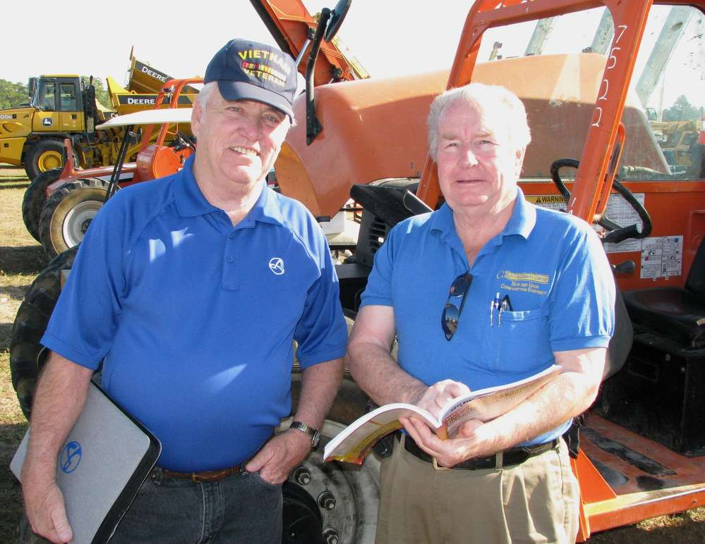 Swapping notes on some reach forklifts of interest are Dave Keel (L) of Armstrong Equipment, Kansas City, Mo., and Dick Courts, Courts Machinery, Windom, Minn.