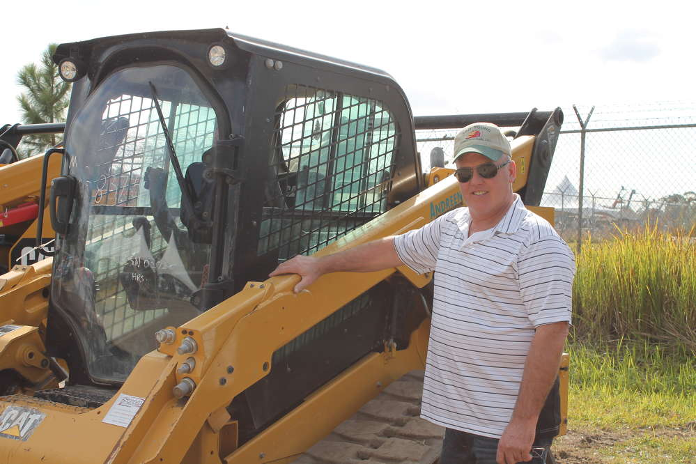 Tad E. Young II, owner of Key II Logging in Skaneateles, N.Y., checks out this Caterpillar skid steer as a potential piece to add to his fleet back home.
