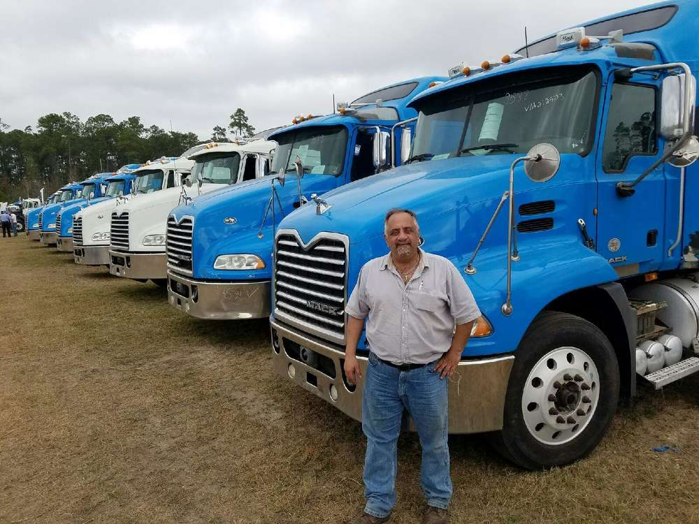 Pete Karis of Metro Motors, Lyons, Ill., provided the equipment hauling services for Alex Lyon & Son's Florida auctions.