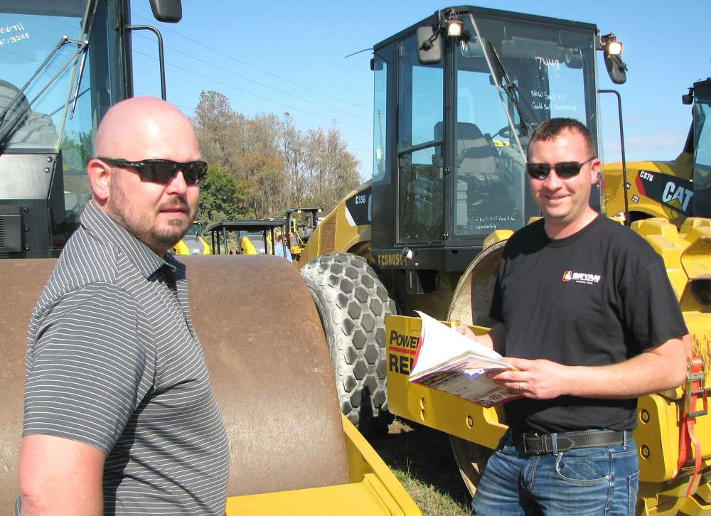 Looking over several compactors of interest are Trent Knudsen (L) and Doug Bryan of Bryan Heavy Equipment, Oelwein, Iowa.