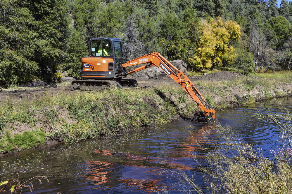 The Doosan DX60R met the weight criteria (under 17,000 lbs.), was equipped with a long-arm option that provided additional reach and was perfect for working on the river.