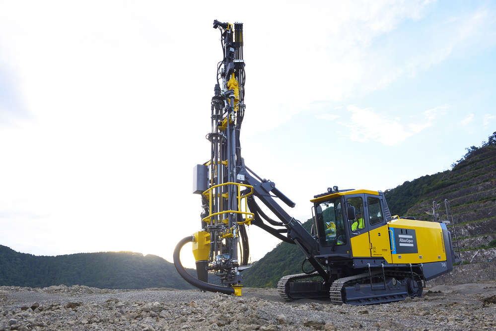 The Atlas Copco PowerROC T45, with telescoping boom, drills precise holes from 3 to 5 inches in diameter.