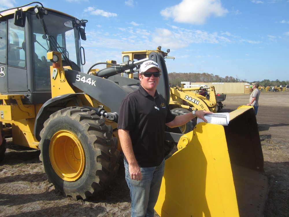 Matt Warren of GMW Equipment, Hidalgo, Texas, looks over this John Deere 544K wheel loader