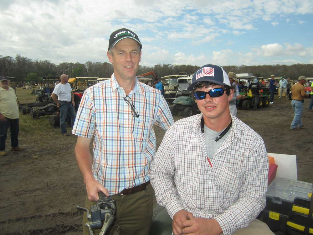 Derek Keys (L), CEO of Euro Auctions UK LTD speaks with Chaz Aleno of Nichols Sandblasting & Painting at the annual auction