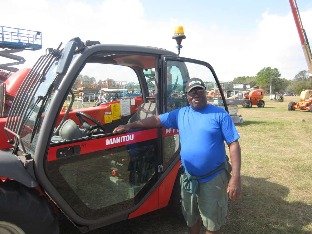 Joseph Adderley of Alex Building Supplies looks over this Manitou MT523.