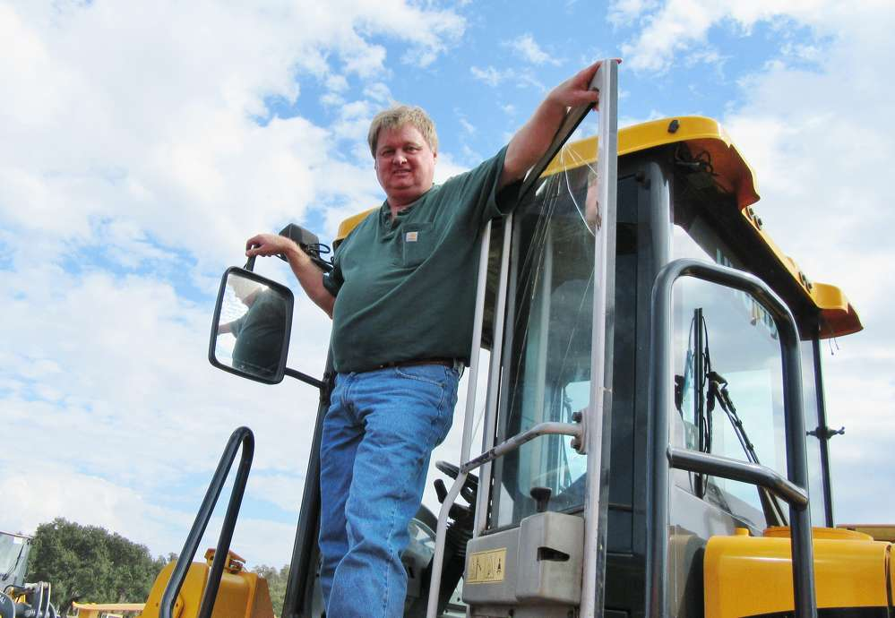 Danny Clark of Clark Heavy Equipment, Pleasureville, Ky., takes a closer look at Hyundai HL757-7 loader at the auction.