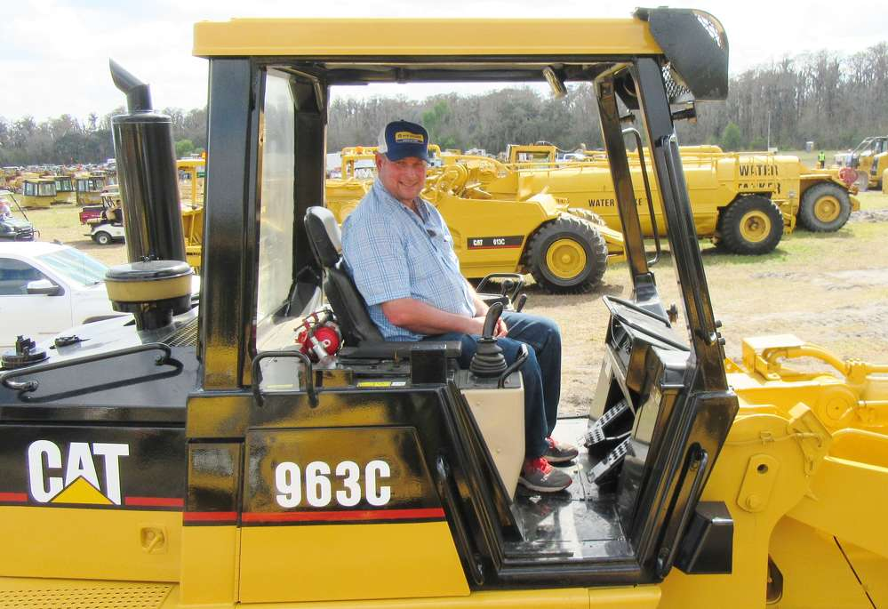 Alfred Post of Post Farms in Ohio admires a Caterpillar 963 C loader at the auction.